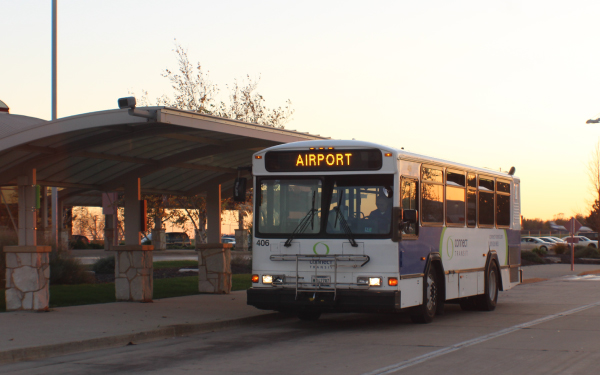 Public transit bus parked outside the terminal at Central Illinois Regional Airport