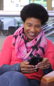 Smiling woman holding a mobile phone